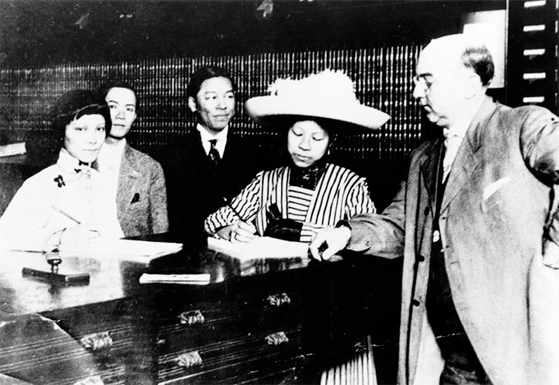 A Chinese woman registers to vote in a court house.