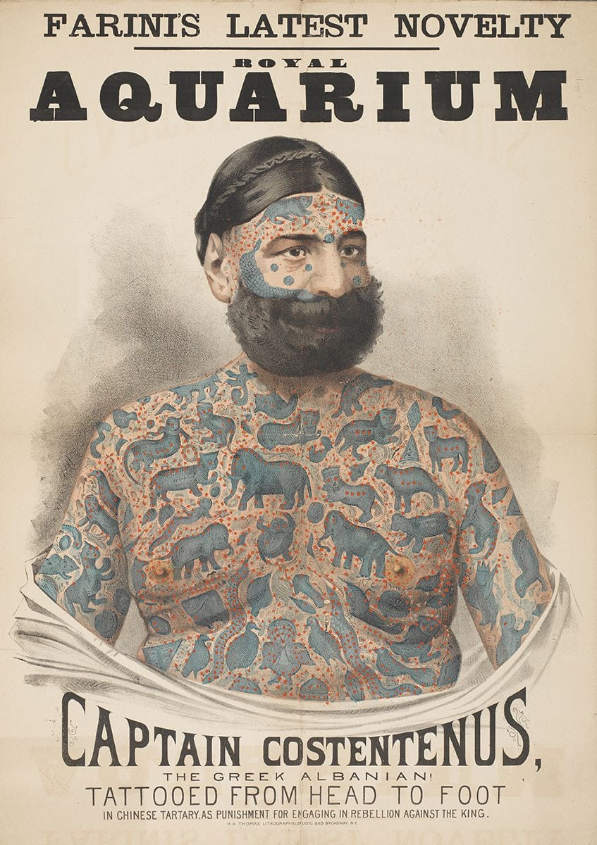"""An old poster shows a drawing of a bearded, fully-tattooed white man. The headline reads, """"Farini's Latest Novelty [at the] Royal Aquarium. Captain Costentenus, the Greek Albanian! Tattooed from head to foot in Chinese Tartary, as punishment for engaging in rebellion against the king."""""""