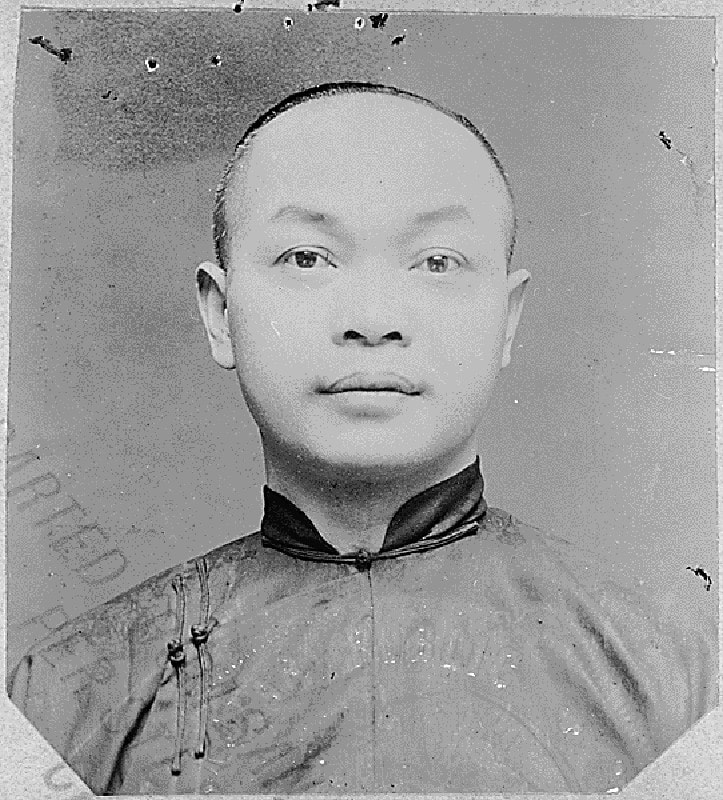 A Chinese man looks at the camera in a passport-style photograph.